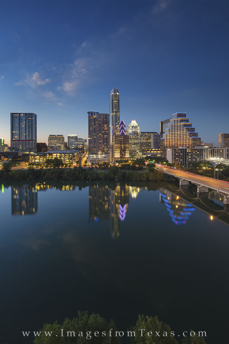 From the top of the Hyatt Hotel on Lady Bird Lake, this is the view of downtown Austin, Texas, on a perfect Spring evening. The...