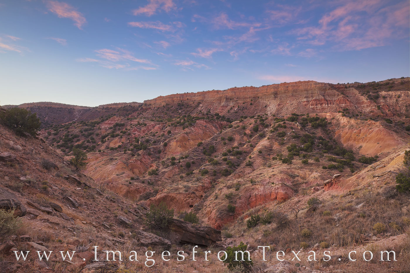 After an early morning scramble to the rim of Palo Duro Canyon, the sun's first light turned the sky pink and blue for a few...
