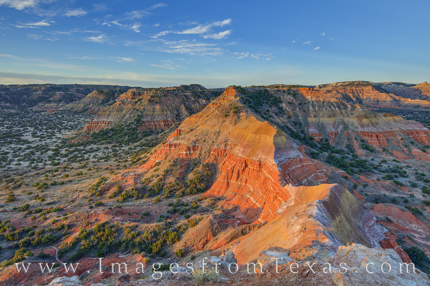 On a 30-degree morning in Palo Duro Canyon, the landscapae begins to show its orange rock as sunlight spreads across sandstone...