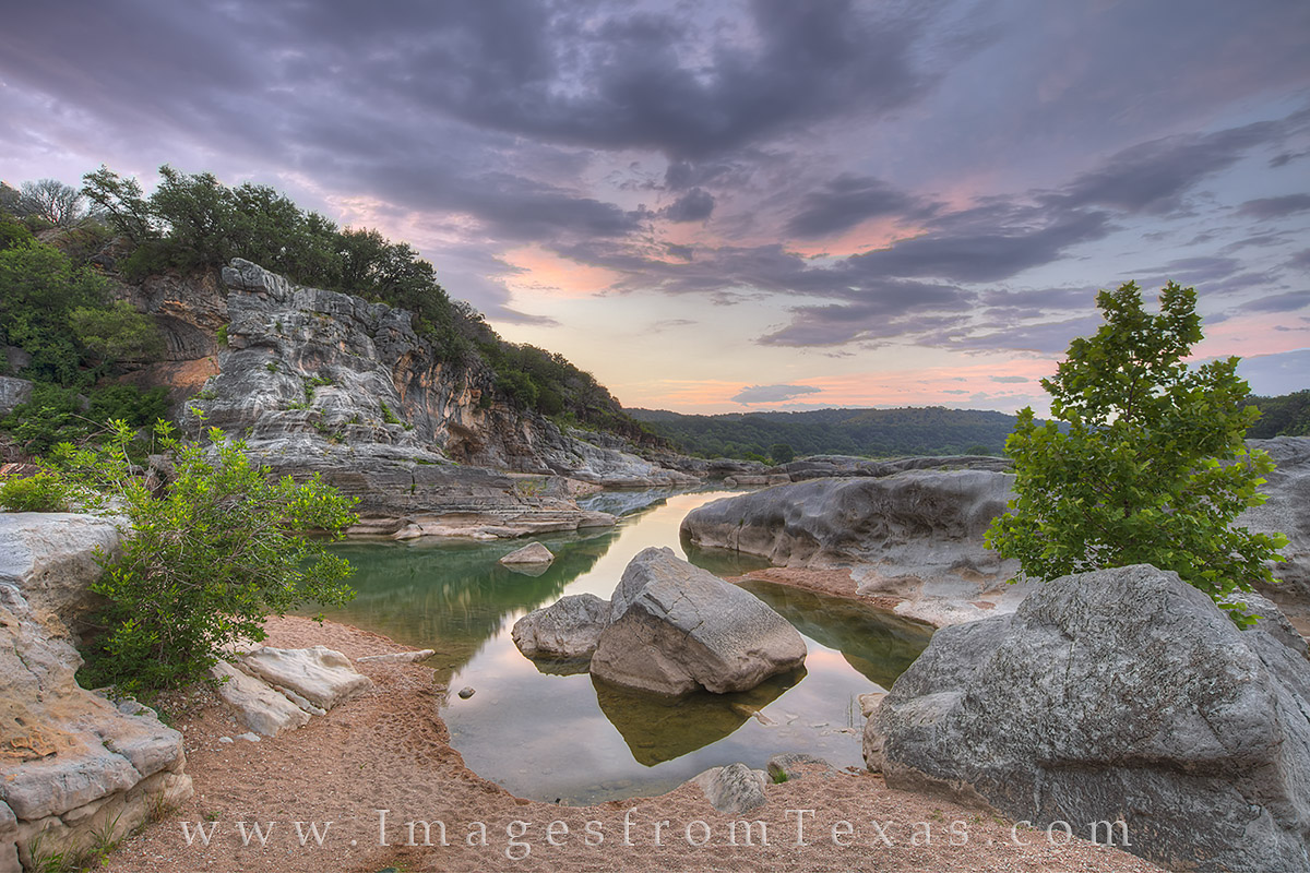 From a small bend in the Pedernales River, this June sunrise in the Texas Hill Country brought pastel shades of purples and pinks...