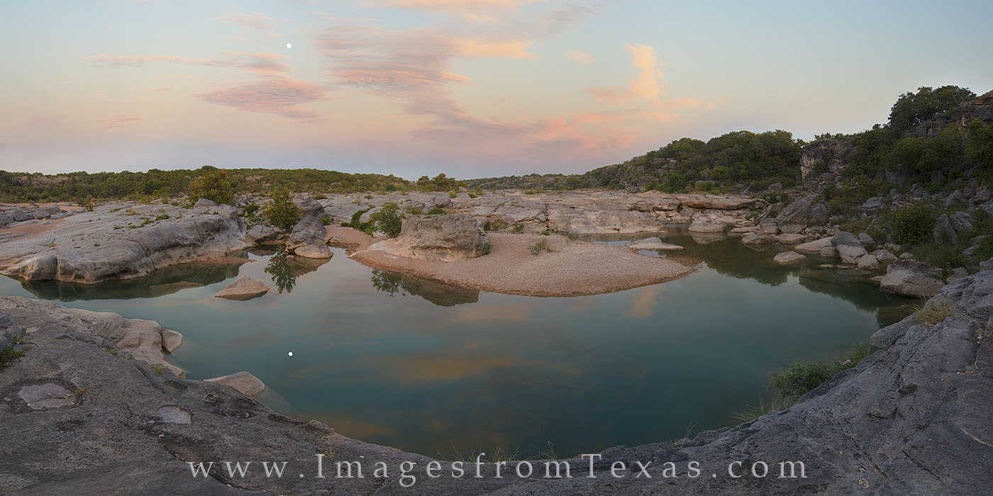 Shooting west at sunrise in Pedernales Falls State Park, the sun turns the clouds a beautiful pastel shades of orange and blue...