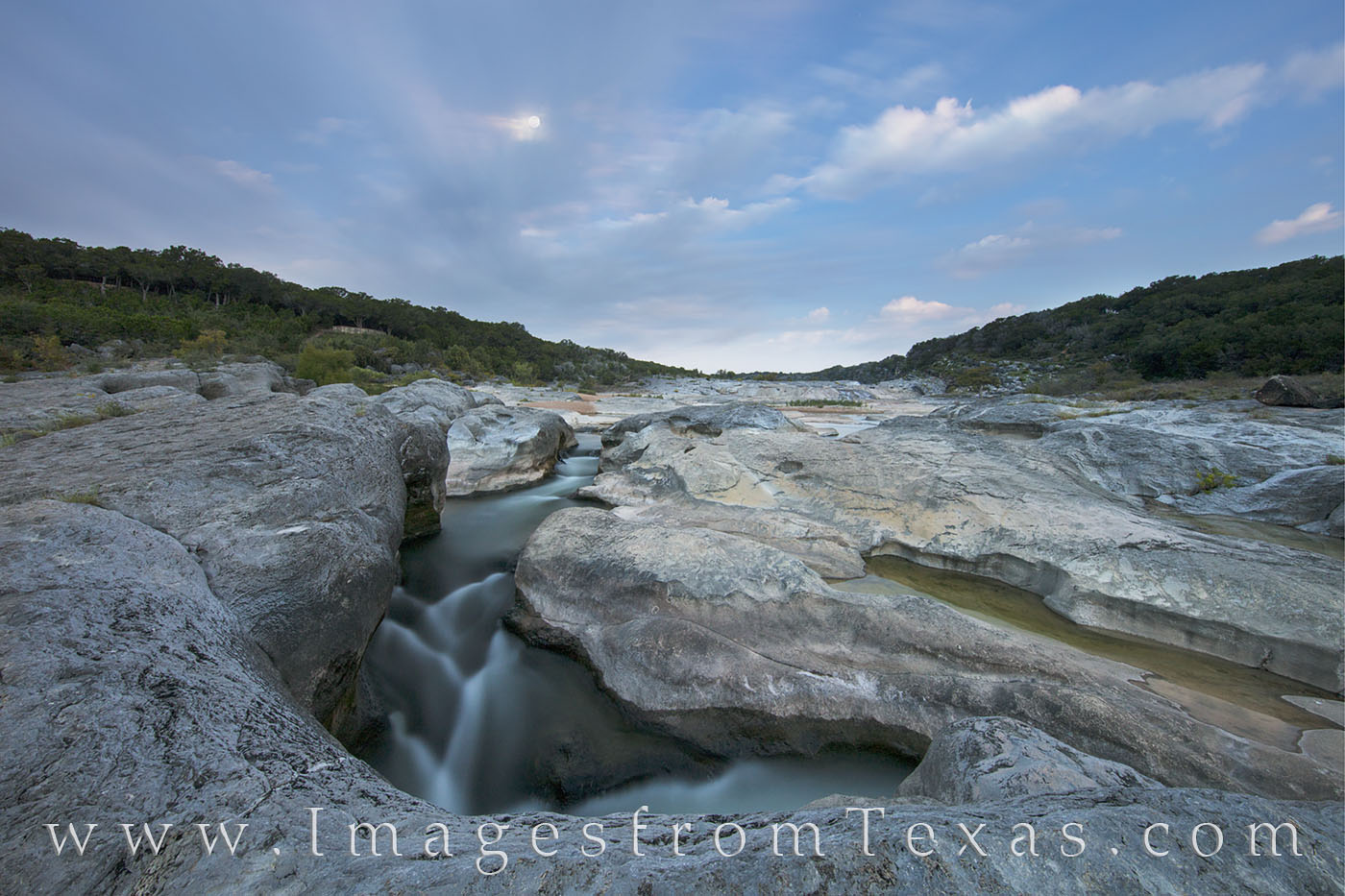 A full moon hangs over the Texas Hill Country, lighting up the landscape in this 92 second exposure. The length of the exposure...