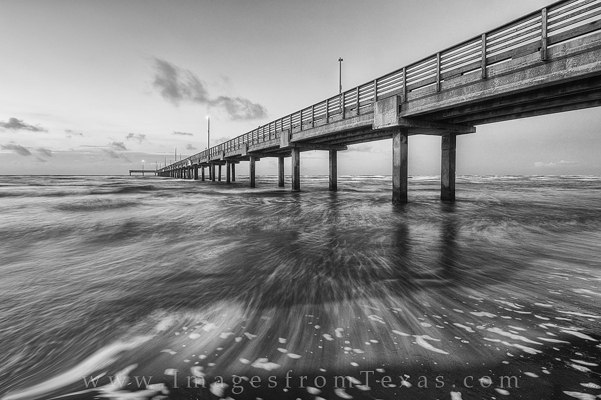 Horace Caldwell Pier stretches out across the warm gulf waters along Port Aransas Beach on a warm June morning.