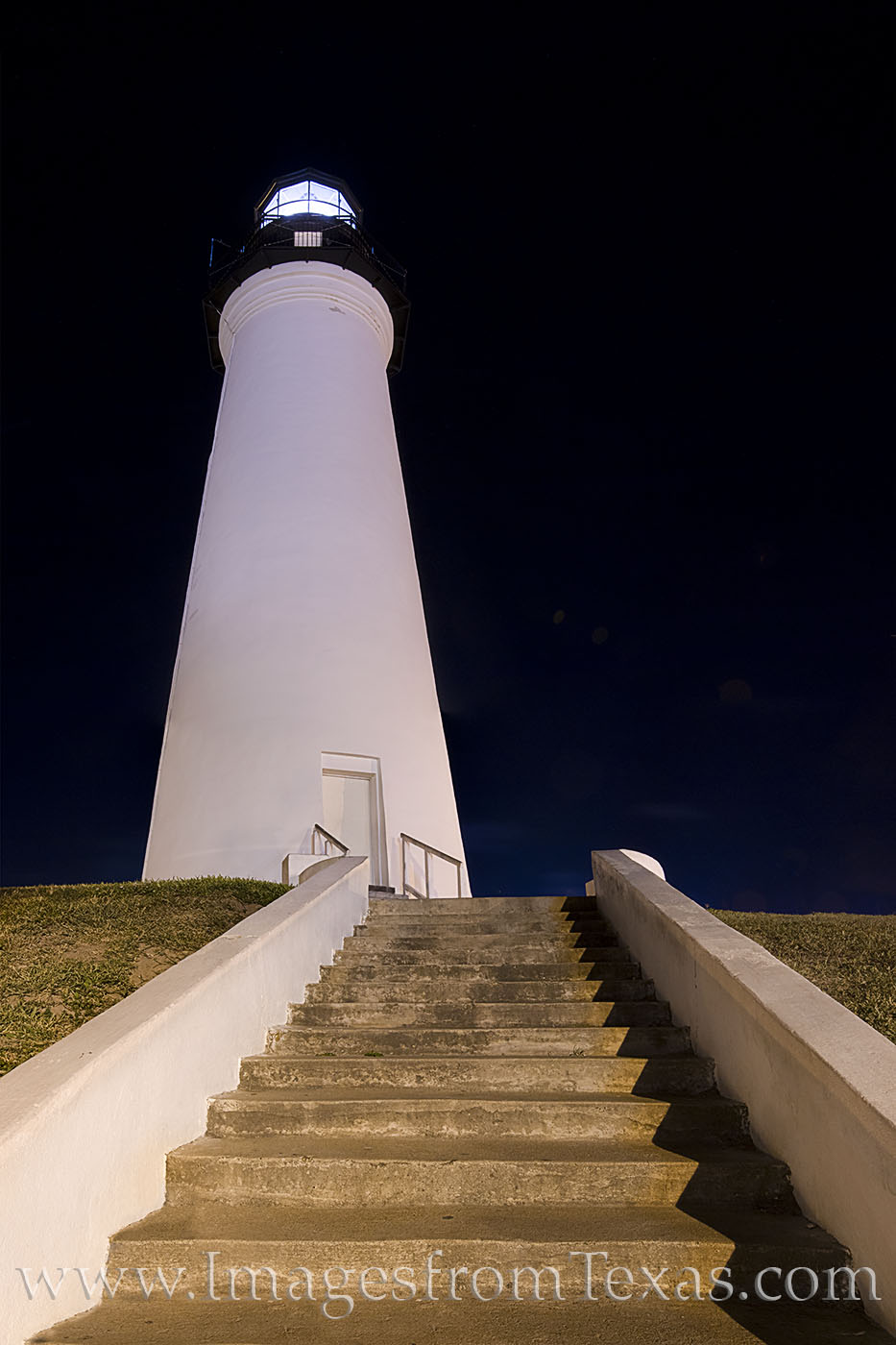 The lighthouse in Port Isabel rises into the night sky. Built in 1852, it served as a beacon for ships for many years. Now, it...