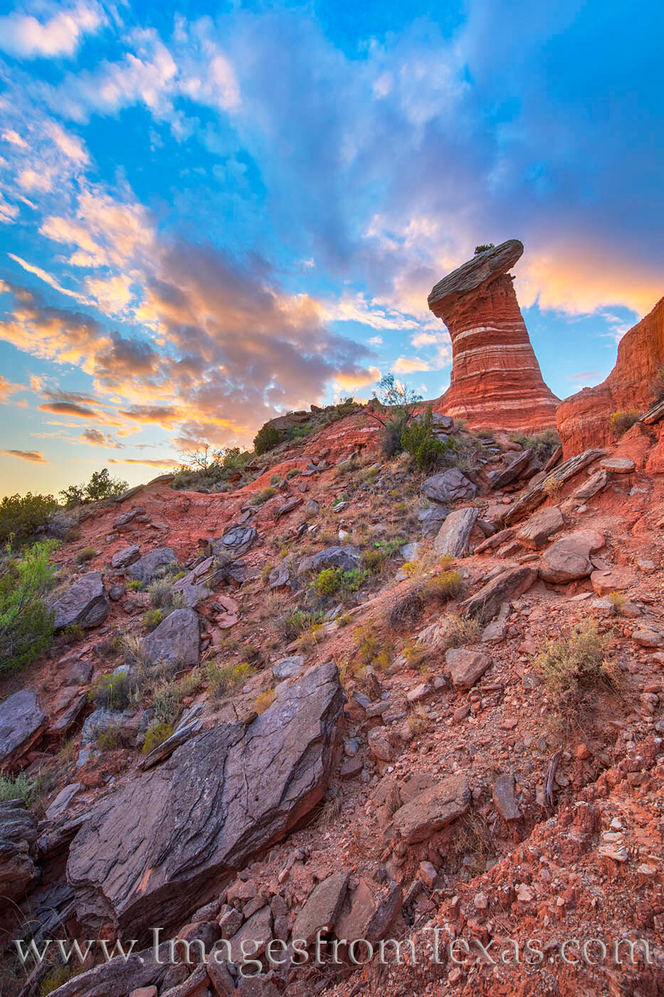 A ways down the GSL Trail in Palo Duro - and a bit off the beaten path - Red Star Hoodoo stands tall in the evening light. Though...