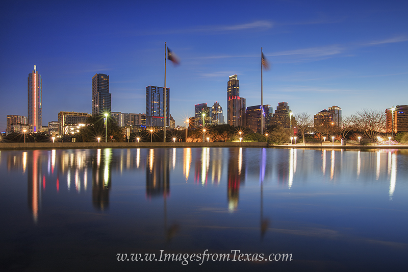 On a cold February morning, the Austin skyline rises into the cold air about 30 minutes before sunrise. The reflection of the...