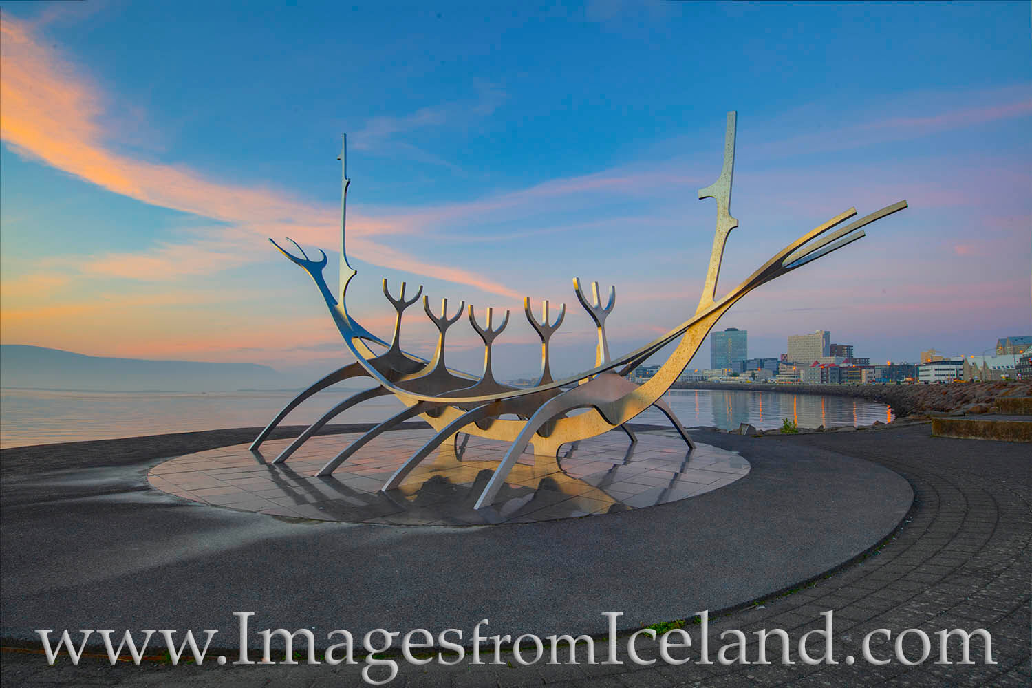 The Sun Voyager, a sculpture by Jón Gunnar Árnason, looks out to the bay and inspires hope of undiscovered lands. In the distance...
