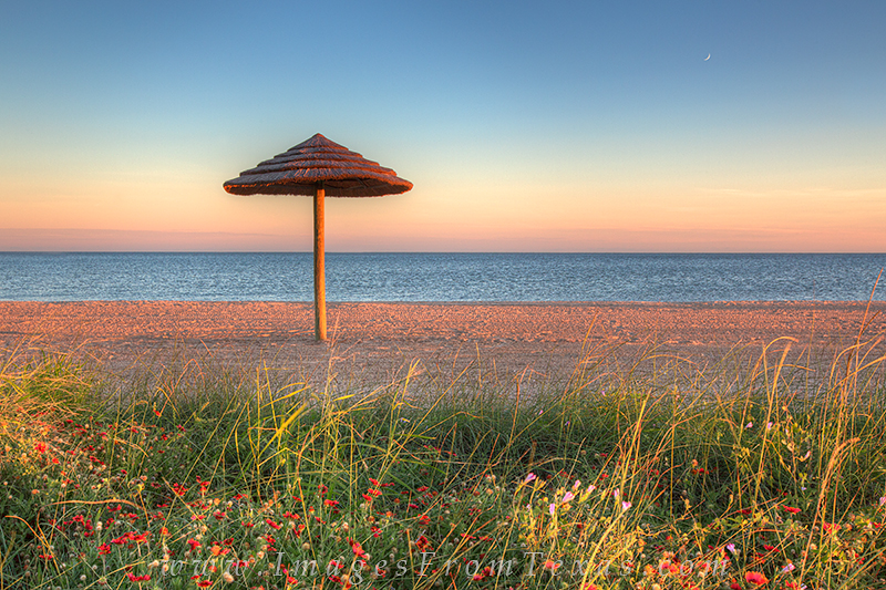 This thatched hut, and many like it, stand along the golden sand at Rockport Beach along the Texas Coast and offer a respite...