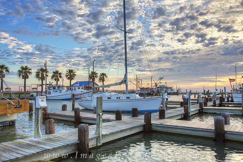 Wonderful clouds drifted over the harbor at Rockport, Texas, in a cool fall morning. I arrived early and had the walkways to...