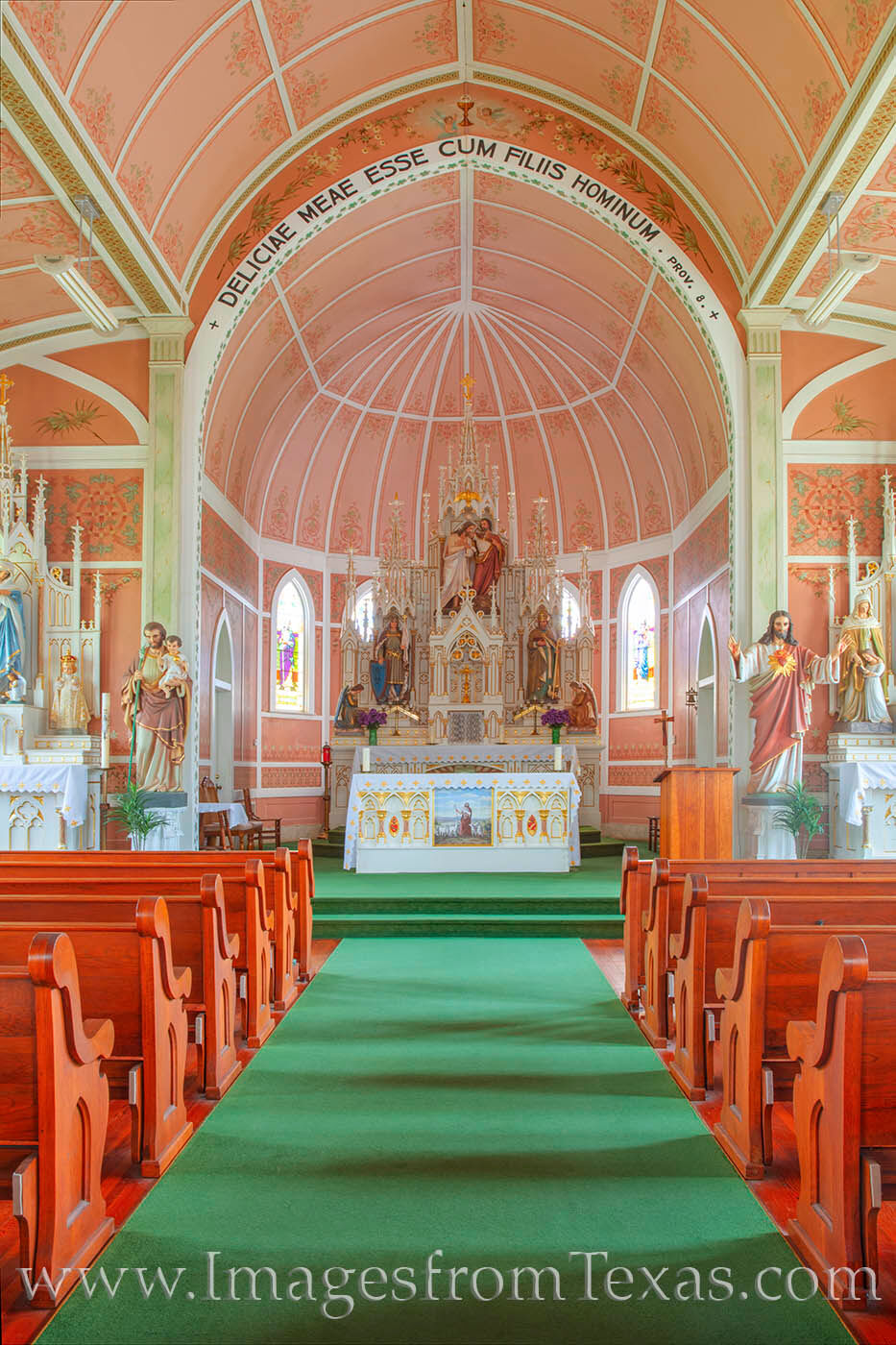 """Known as the """"Pink Church,"""" St. John the Baptist Catholic Church is located in Ammannsville, Texas. The parish has been rebuilt..."""