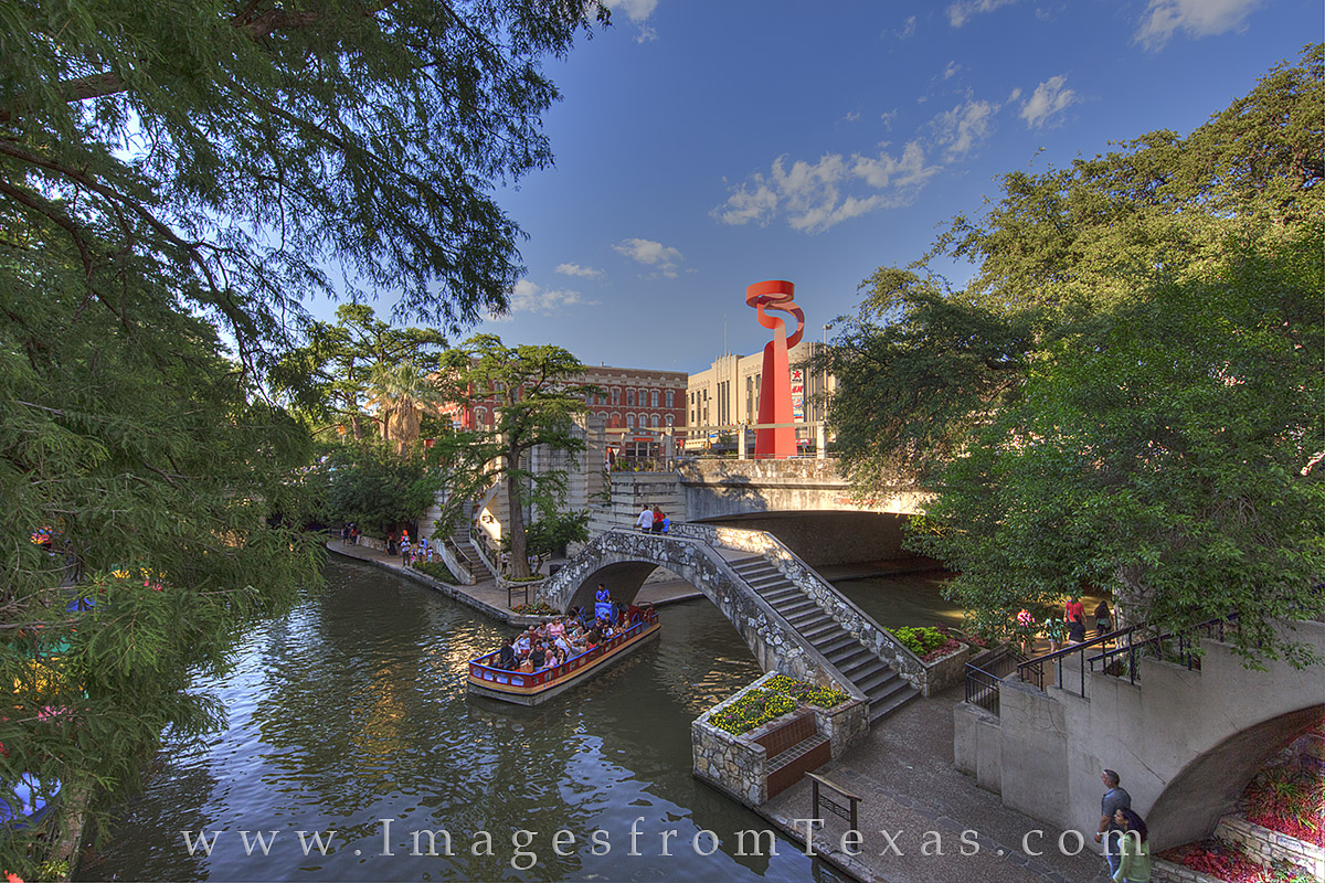 The San Antonio Riverwalk provides great walking for locals and tourists on a summer evening. Boat rides are also available to...