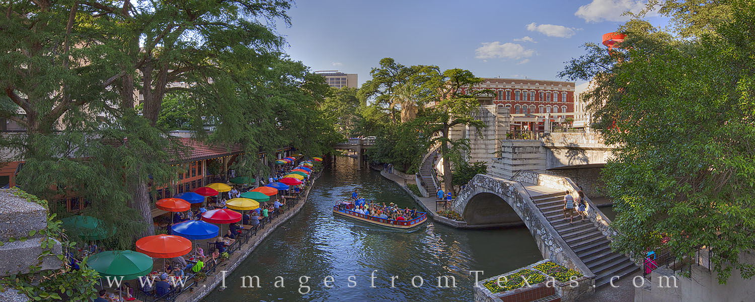 This panorama shows San Antonio's famous Riverwalk on a late summer afternoon. Casa Rio, one of the most well known Mexican restaurants...