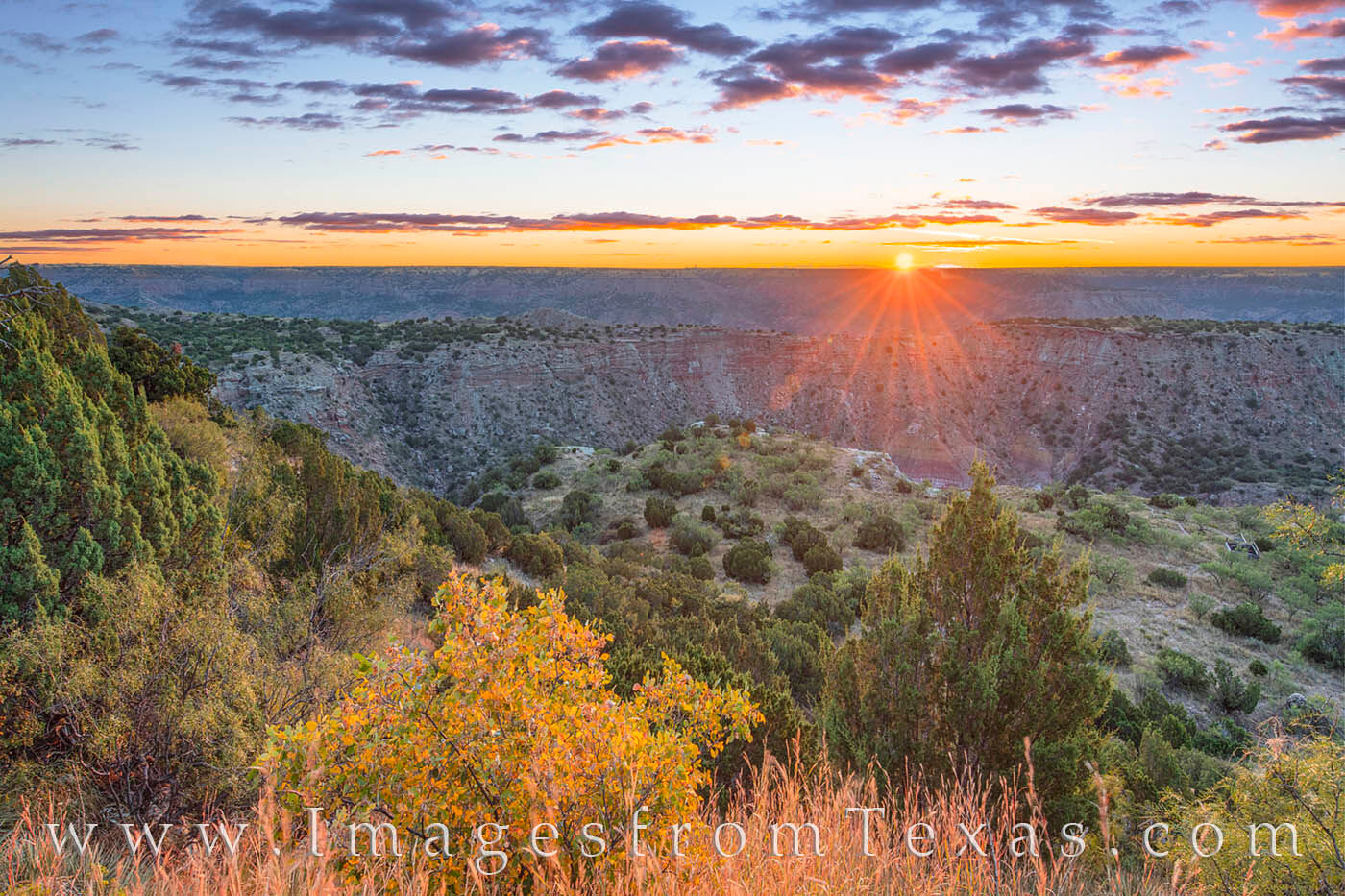 With a little touch of fall colors, this photograph shows a chilly late September sunrise looking over the famous Texas canyon...
