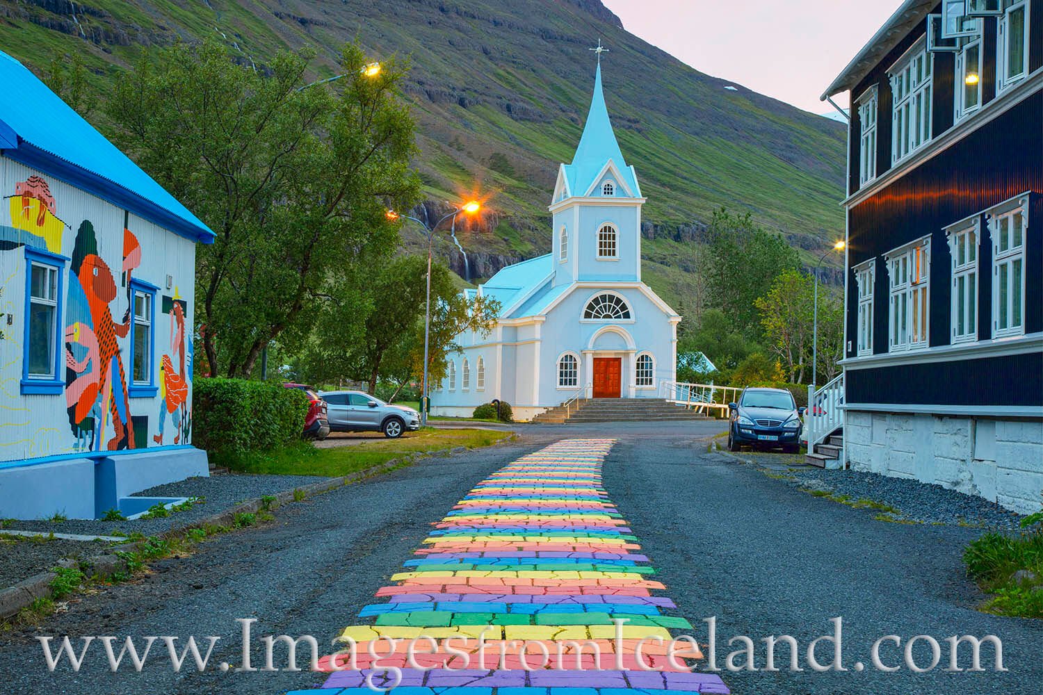 The Blue Church in the east Iceland village of Seydisfjordur is an icon of the town, as is the rainbow colored street in the...