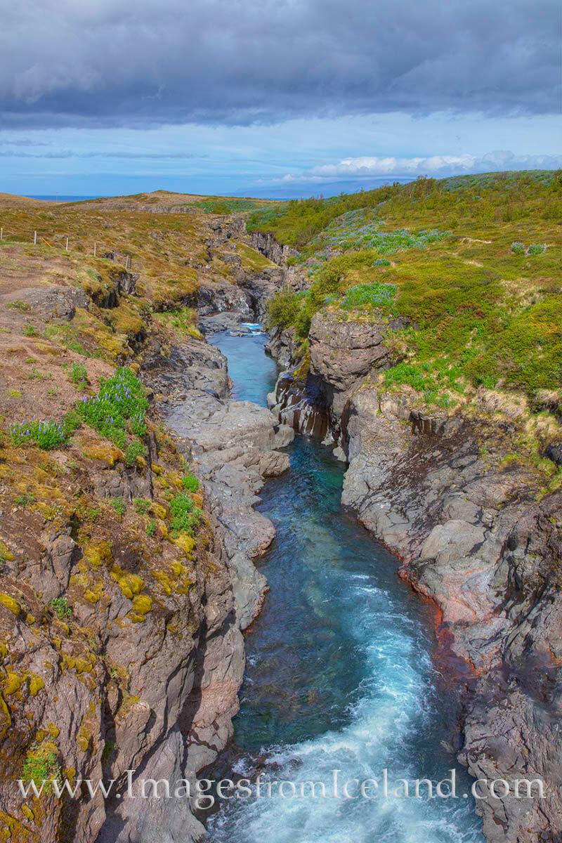 On a dirt road between Grundarfjörður and Husavik, this little canyon was worth a quick stop. The aqua-blue color of the water...
