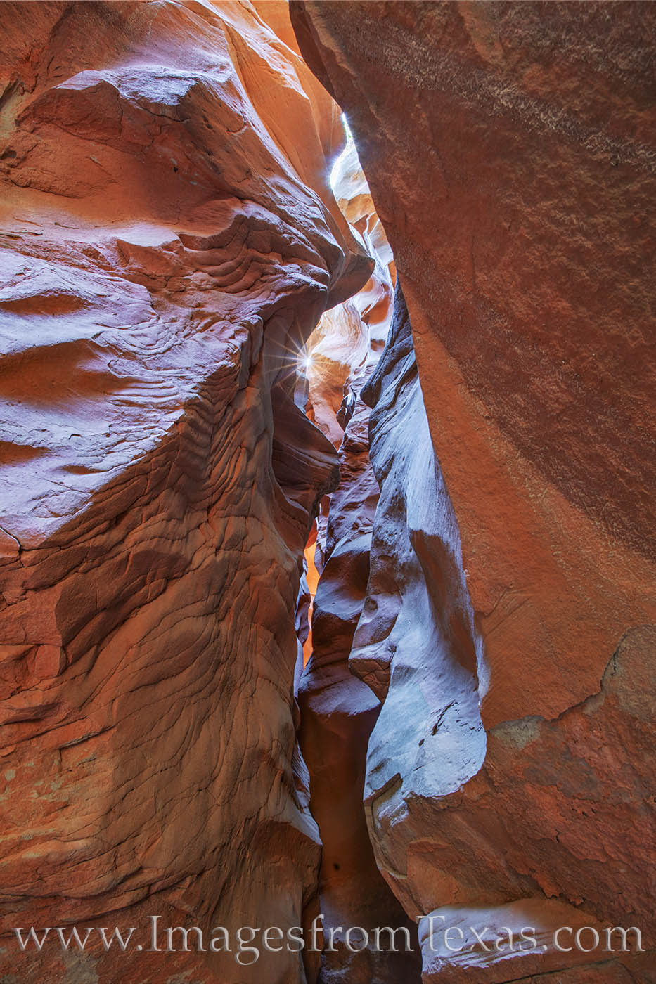 In passageways that are nearly too narrow for a person to fit through, the sun's rays sneak through this beautiful slot canyon...