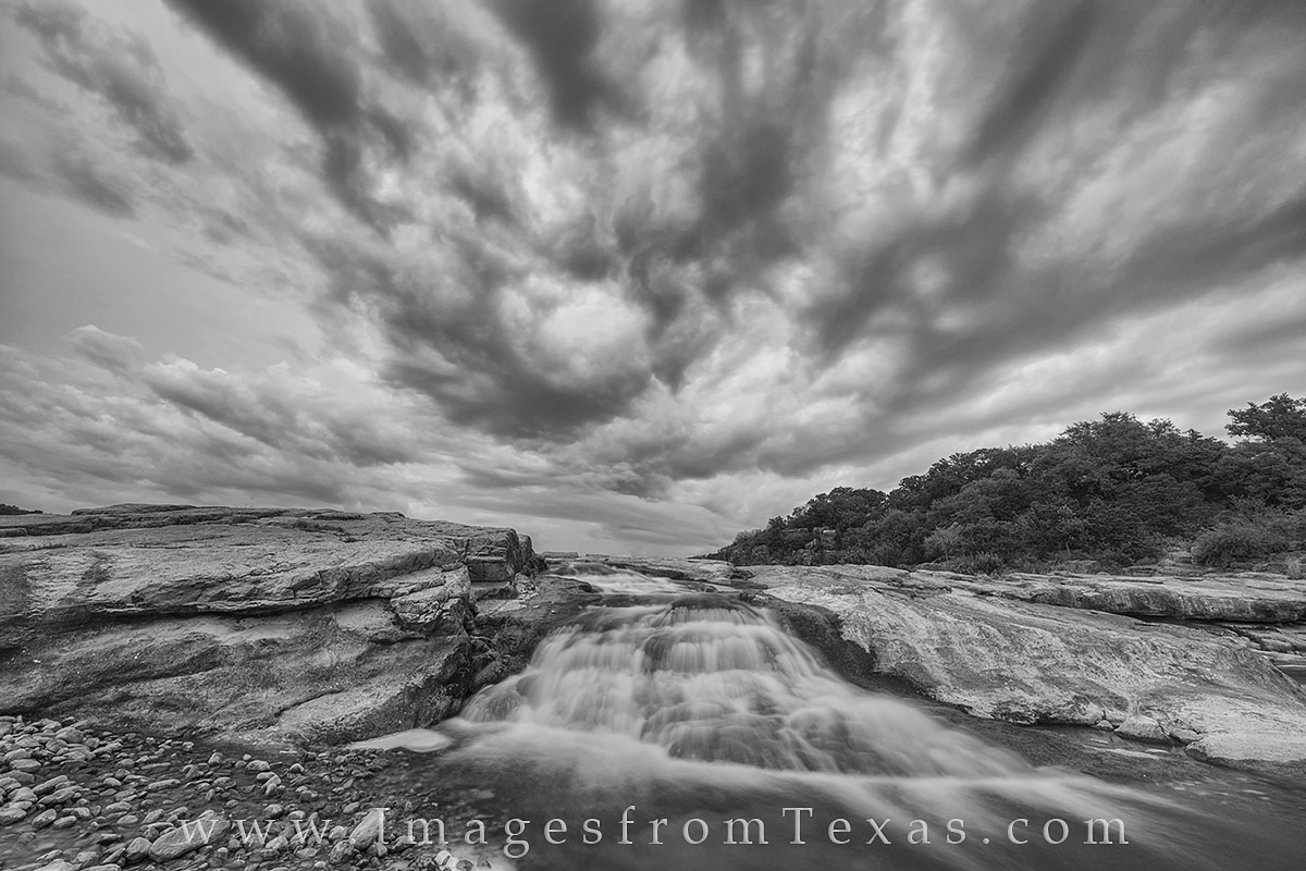 I don't often shoot with the intent of creating a black and white image, but these clouds over a small waterfall at Pedernales...