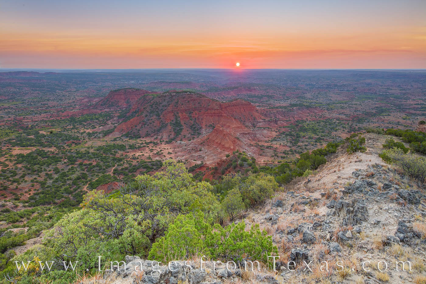 On a quiet morning high atop Haynes Ridge in Caprock Canyon, the sun made its appeaerance on the horizon. The first light colored...