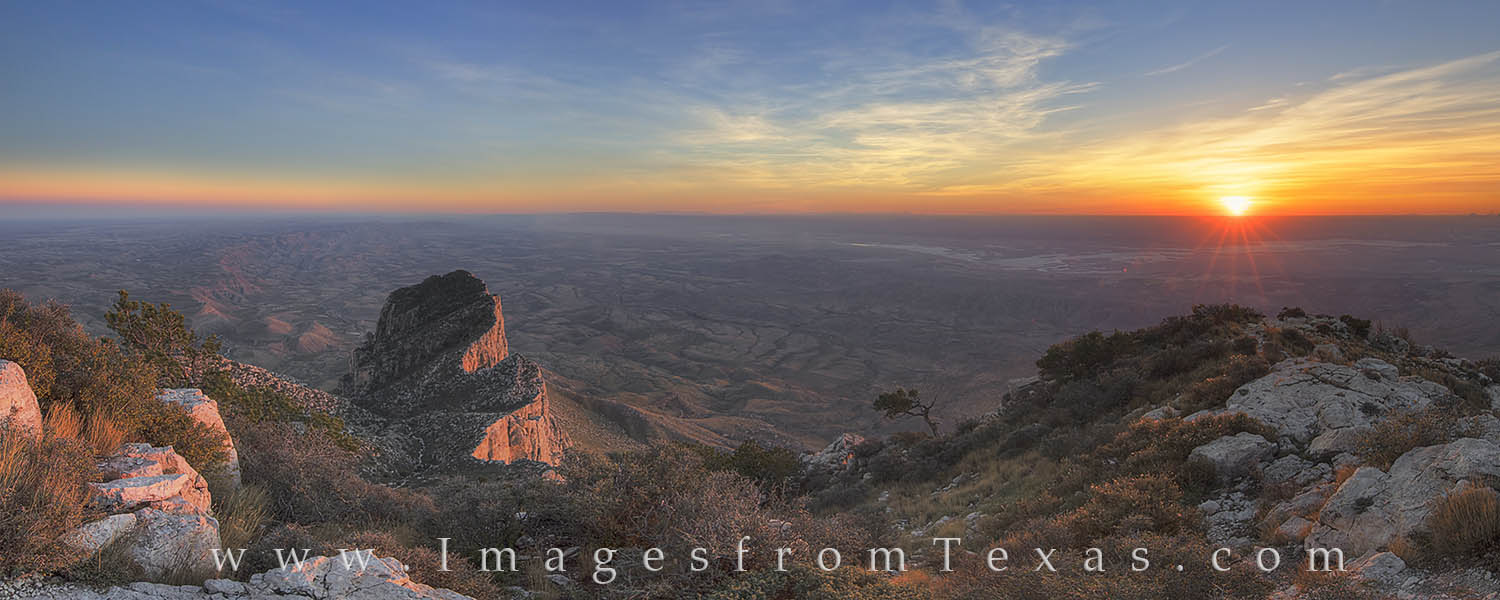 This panorama from Guadalupe Peak shows a beautiful west Texas sunset from Guadalupe Mountains National Park. At this elevation...
