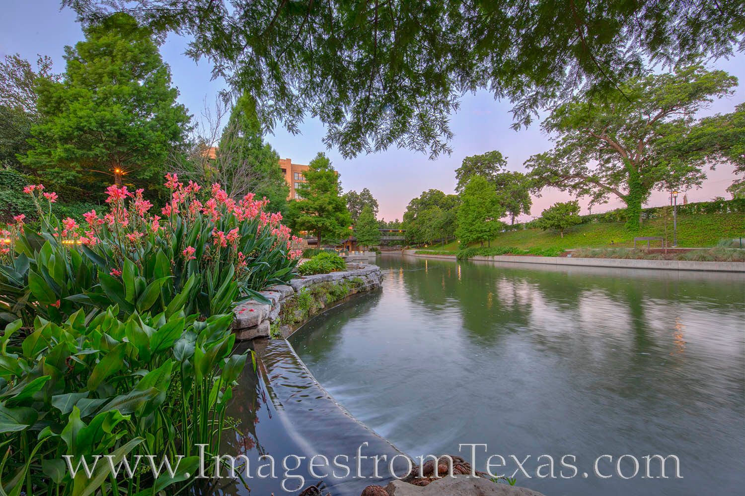 A little before sunrise, the sky was soft and pastel near downtown San Antonio. This area sees the San Antonio River flow gently...