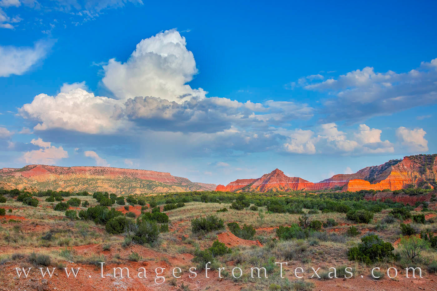 A thundercloud rises in the distance and looms over Capitol Peak in Palo Duro Canyon. Seen here from the GSL Trail near Red Star...