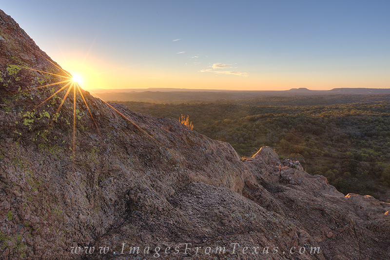 From the side of Turkey Peak at Enchanted Rock State Park, this is a November sunrise. The views of the Texas landscape from...