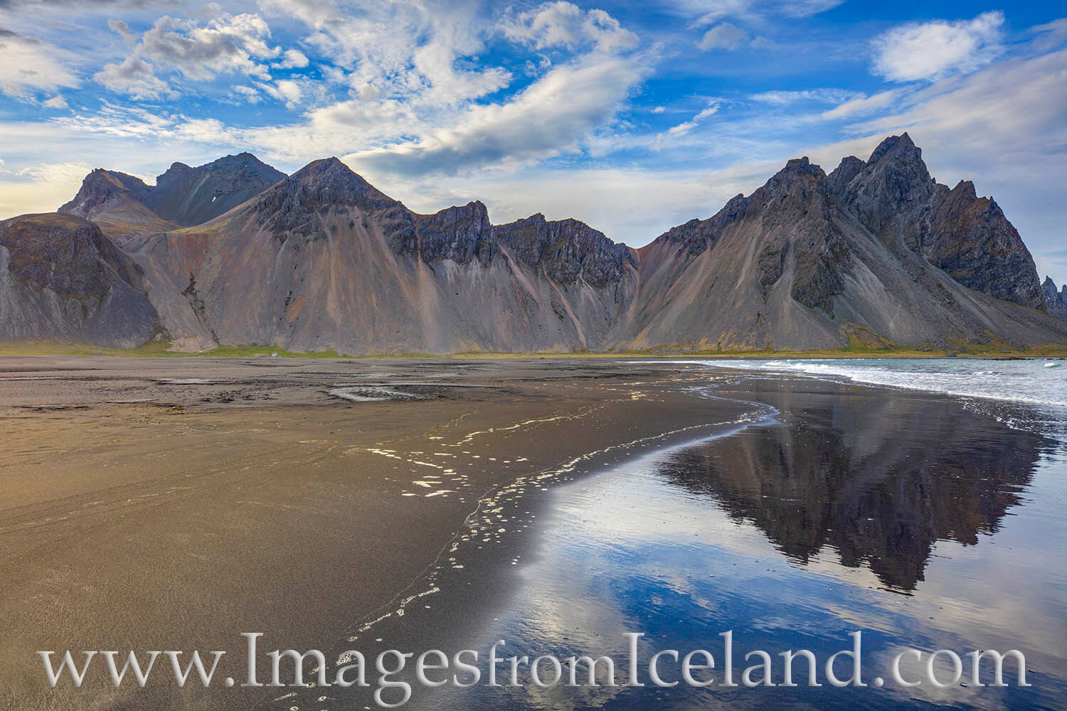 Near the little village of Höfn, the Vestrahorn rises 454 meters above the black sands beach and Atlantic Ocean. Seen here on...