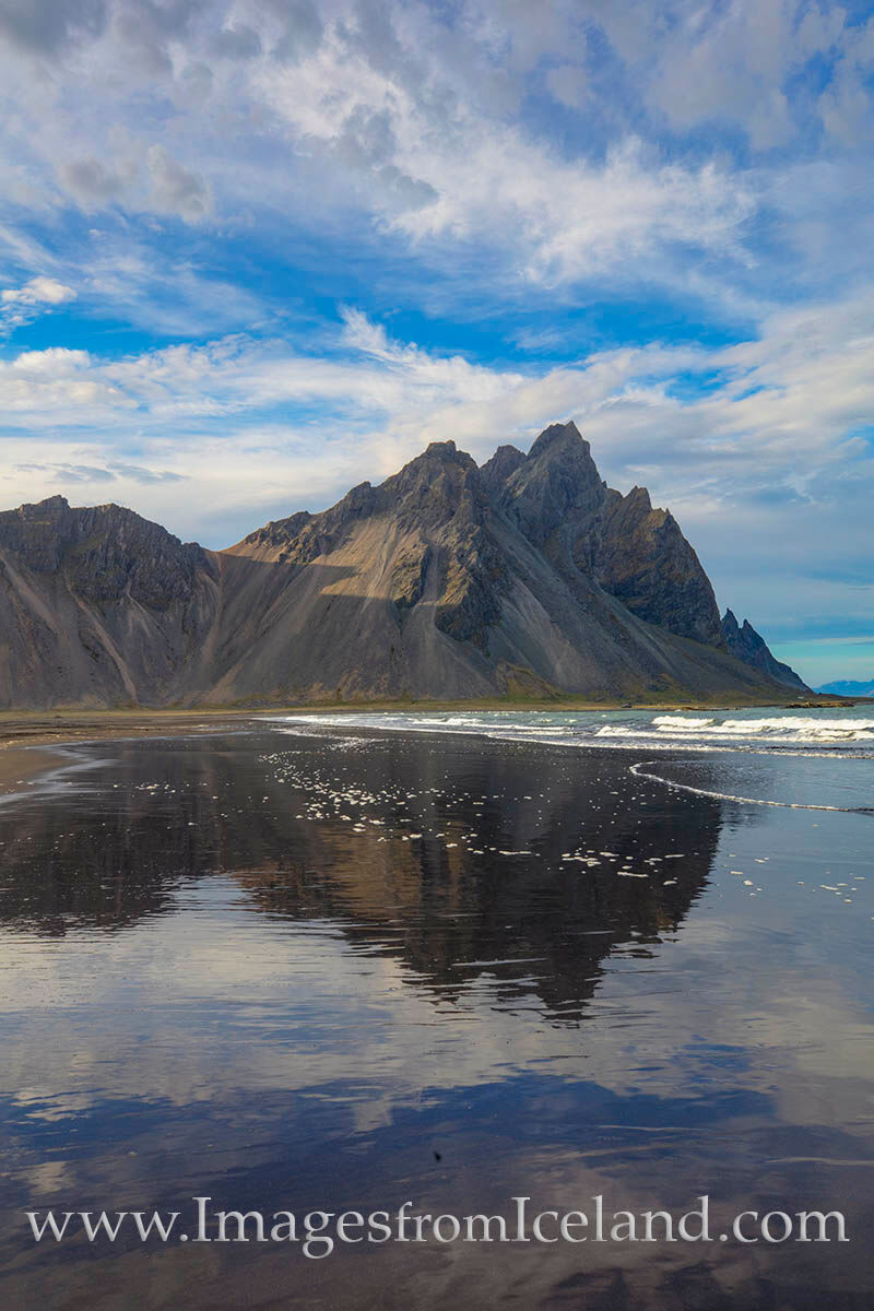 The black sands beach in the shadow of Vestrahorn near the little town of Höfn offers great reflections of the 1490' mountain...